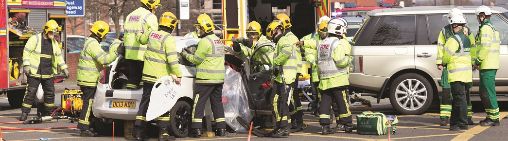 EKMDJW Chris Bull . WED 8-4-15. ALTRINCHAM  , Fire and ambulance crews attend a crash between a Ford Ka and a Range Rover